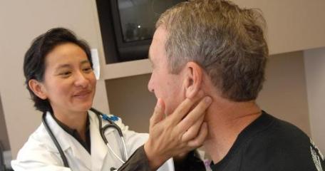 Dr. Attaya Suvannasankha examines patient