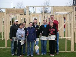 Helping to construct new homes with Habitat for Humanity