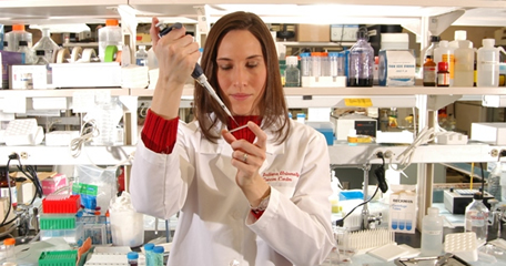 Lacey Dobrolecki, research  technician, in the lab
